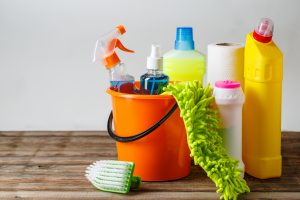 Orange bucket of cleaning products
