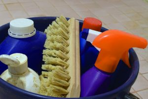 Bucket of dirty cleaning supplies