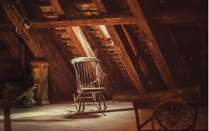 Old attic with a rocking chair in the center