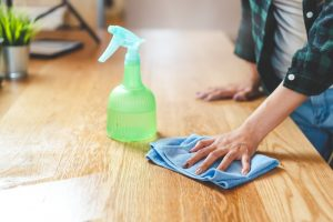 Hand with glove cleaning floor RCH Cleaning Cleaning Wood Properly
